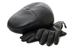 Black gloves and a cap Stock Photography