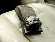Black Gloves on the Front Seat Royalty Free Stock Photography
