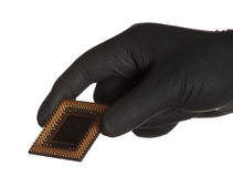 Black gloves holding microprocessor Stock Photo