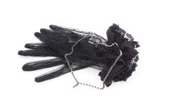 Black gloves with lace and black jewelry necklace Stock Image