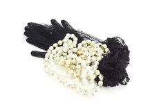Black gloves with lace and pearl necklace Royalty Free Stock Photos