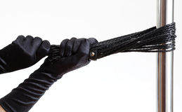 Black gloves, whip and pole Royalty Free Stock Image