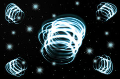 Black_glowing swirl_abstact. Black   background with withe glowing swirl and some shining stars and space Royalty Free Stock Photos