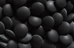Black go stones Stock Images