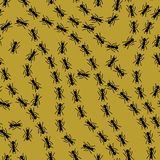 Black on gold ant lines pattern seamless repeat background. Two colour simple ant lines pattern seamless repeat background. Could be used for background pattern Royalty Free Stock Photo