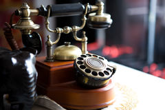Black gold antique vintage telephone, abstract of communication Royalty Free Stock Photos