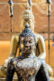 Black and gold color buddha statue attch  by gold plate in Thail Stock Photography
