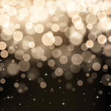 Black and gold defocused bokeh lights background. This image was made by an illustrator. Vector EPS 10 format Royalty Free Stock Photos