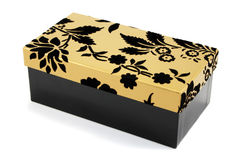 Black and Gold Gift Box. Black gift box with black flock and gold lid on a white background Royalty Free Stock Photo