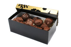 Black and Gold GiftBox with Chocolates. Fancy black and gold giftbox with handmade luxury chocolates Stock Photo