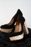 Black and gold high heels Royalty Free Stock Images