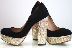Black and gold high heels Royalty Free Stock Image