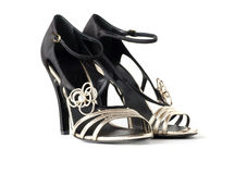 Black and gold ladies sandals Stock Photo