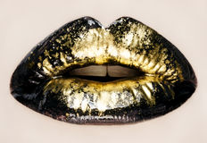 Black and gold lips close up. Macro photography royalty free stock photos