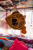 Black and Gold Mexican Sombrero Hat Hanging in Travel Van with U. Kulele stock image