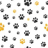 Black and Gold Pawprint Background. Black and gold glitter pawprints in a white seamless tiling background Stock Photo