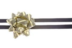 Black and gold ribbon. Used for decoration isolated on white background Royalty Free Stock Photo
