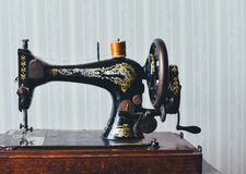 Black and Gold Sewing Machine Stock Images