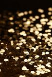 Black and Gold Sparkle Glitter background. Holiday, Christmas, Valentines, Beauty and Nails abstract texture Stock Photo