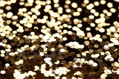 Black and Gold Sparkle Glitter background. Holiday, Christmas, Valentines, Beauty and Nails abstract texture Stock Images