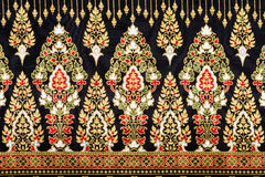 Black and Gold Thai Silk Fabric, background and pattern. Beautiful and elegant Thai pattern on silk fabric Stock Images