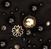 Black and golden beads on black fabric Stock Photography