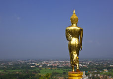 Black golden buddha statue and blue sky Royalty Free Stock Photos