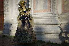Black Golden costumed masked woman. At San Zaccaria in Venice Stock Image