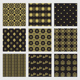 Black and golden geometrical and Art Deco patterns set. Black and golden modern and geometrical Art Deco patterns set Royalty Free Stock Photography