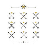 Black and golden hand drawn tribal crossed arrows icons set Stock Image