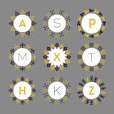 Black and golden monograms circle pattern emblems set Stock Image