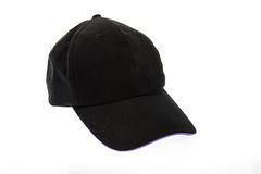 Black golf cap with purple colour trim on white background Royalty Free Stock Image