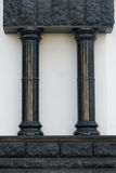 Black gothic columns. On the street Stock Photos
