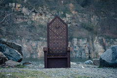 Black gothic throne. Against the dark rocky mountains, vampire, hip toning, creative color, dark-Boho Stock Image