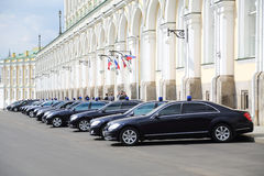 Black government cars are near Grand Kremlin Palace Royalty Free Stock Images