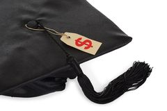 Black graduation cap with tassel and price tag Royalty Free Stock Photography