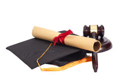 Black Graduation Hat with Diploma and Gavel Royalty Free Stock Photo