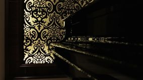 The black grand piano. Luxury hall interior musical keyboards instrument stock footage