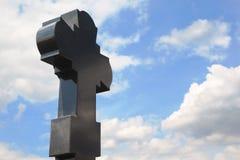 Black granite cross on cemetery Royalty Free Stock Photos