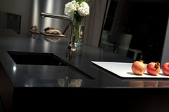 Black Granite Kitchen. Cool and Classy, Modern and Stylish Kitchen with Black Granite Stone Worktop Royalty Free Stock Photography