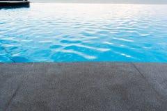 Black granite stone pool edge. Focus on black granite stone pool edge  background used for display or montage object Stock Photo