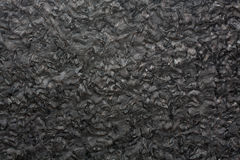 Black granite texture on macro. High resolution photo Stock Image