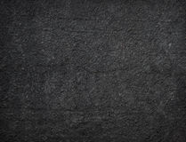 Black granular textured background. Blank asphalt background - Dark ground material, black granular wall texture Stock Photo