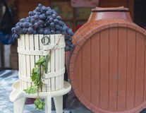 Black grape and brown cask. Sweet and biological grape near an brown cask Royalty Free Stock Photography