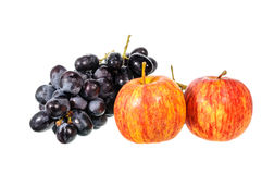 Black grapes and apple Royalty Free Stock Photos