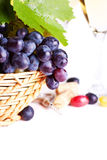 Black grapes in a basket. Royalty Free Stock Images