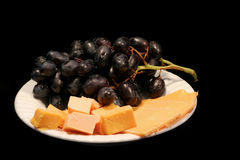 Black grapes and cheese Royalty Free Stock Photos