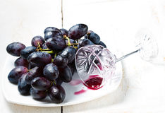 Black grapes and red wine Royalty Free Stock Photo