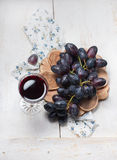 Black grapes and red wine Stock Photo