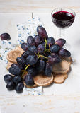 Black grapes and red wine Royalty Free Stock Photography